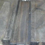 Sow block after weld prep and flood welding. Ready for machining. Weld repaired cracking in the die seating and dowel pocket area.