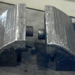 These manipulator jaws were weld prepped, flood welded, and hand ground to customer specs. Will be used in this condition.